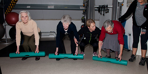 Marion training a group of older clients with 2KG ViPR's