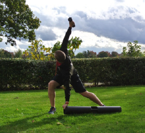 Trainer performing ViPR stretch